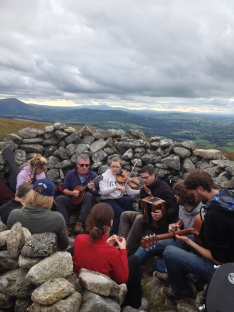 Music at the top of Church Mountain last year, among those playing are Aoife Doyle, Eric & Orla Greaves alongside visiting Breton musicians Jaouen Le Goic, Camille Philippe & Tom Lemmonier